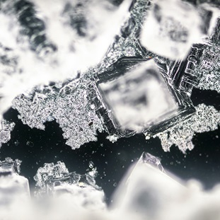 sodium chloride crystallization on black background under polarized light